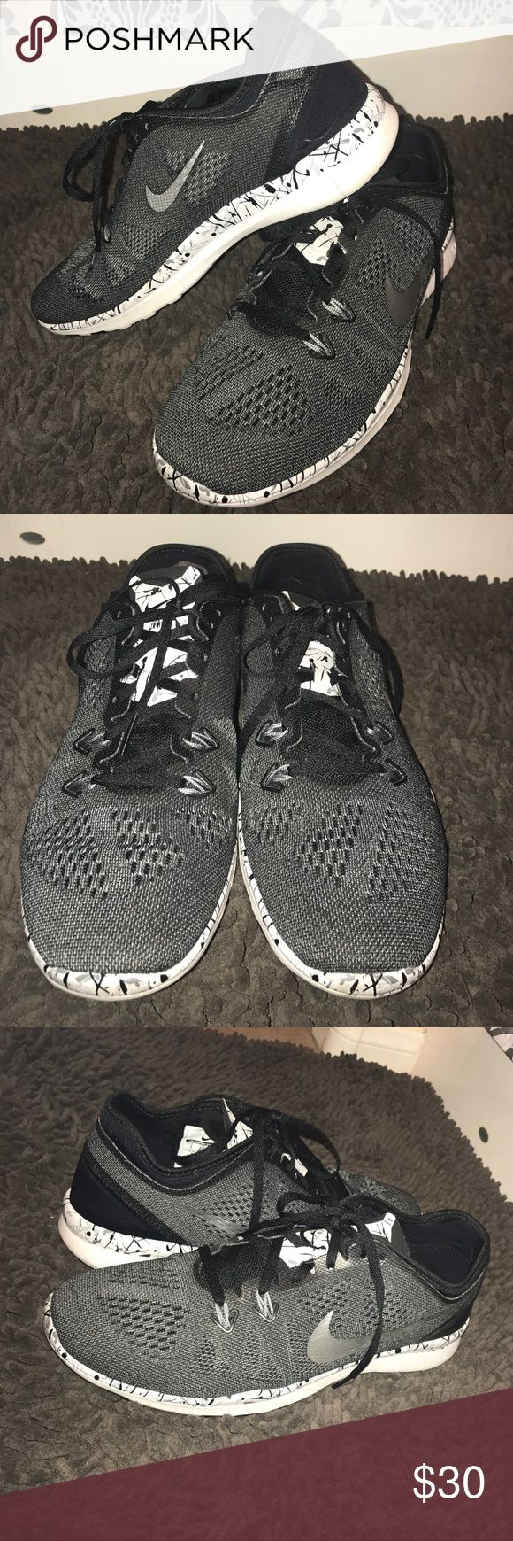 Nike Free TR Fit 5.0 Nike Free TR Fit 5.0. Size 9. Only worn indoors. Gorgeous Charcoal Gray with Black. This is a sleek shoe! Nike Shoes Athletic Shoes