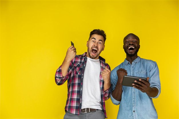 Download European And Afroamerican Guy Are Sincerely Excited With The Tablet And Credit Card In Hands For Free In 2020 Studio Portraits Free Photos Handsome Men