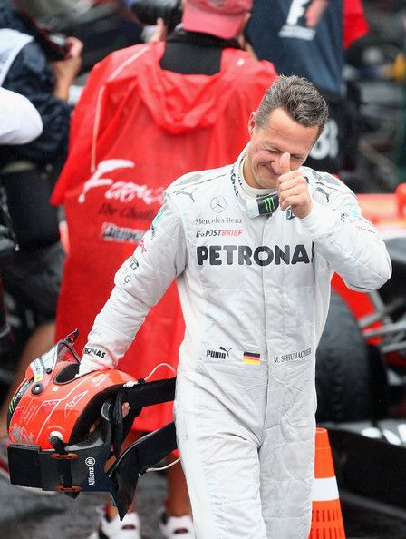 Michael Schumacher of Germany and Mercedes GP reacts in parc ferme after finishing his last F1 race following the Brazilian Formula One Grand Prix