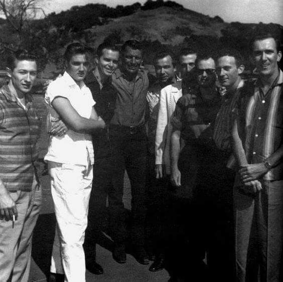 Elvis and Scotty....A Cropped Photo That Originally Showed From to Right, Scotty Moore, ELVIS, Neil Matthews, Richard Egan, Bill Black, DJ Fontana, Gordon Stoker, Hoyt Hawkins and Hugh Jarrett On The Set of 'Love Me Tender' Which Was Filmed From August 23 to October 8, 1956.....