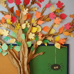 Bring the beauty of autumn indoors to your favorite room. This tree is made entirely of butcher and construction paper.