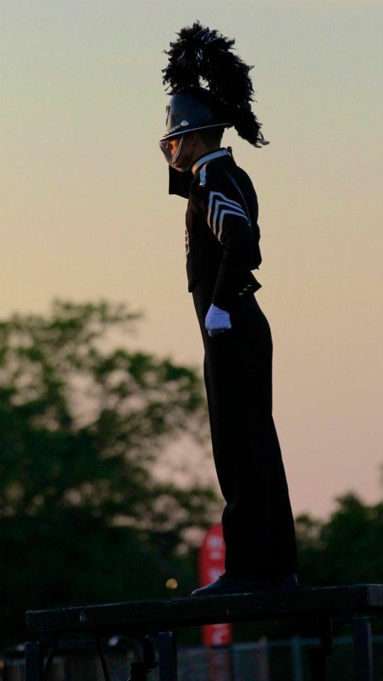 """DRUM MAJOR...IS YOUR CORPS READY?"" 2012 Phantom Regiment drum major salutes the crowd and announcer in-acknowledgment, Rockford College (IL)..."