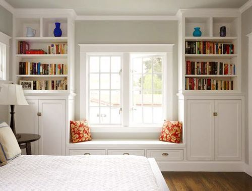 classic small bedroom solution: window seat with matching shelves & cabinets on each side