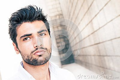 Impasse. Italian handsome man. Close style portrait. Outdoors.