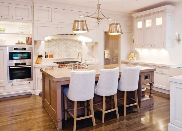 This bright and spacious kitchen is fit for a busy family that loves to entertain.  Design: Alanna L Johnston, Living Environments Style: Transitional Square Footage: 425  Vote in our Ultimate Kitchen Contest here: www.hlmagazine.com/kitchencontest