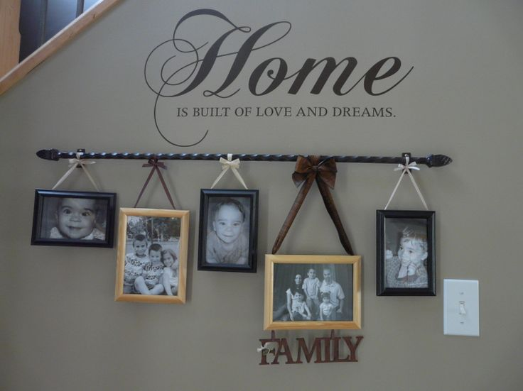 LOVE THIS! Curtain Rod and some ribbon to hang the pics!!