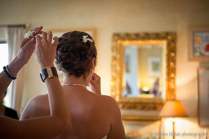 Final details... Makeup & hair by Antigoni Livieratou. Photo by Studio Gakis #bridal #makeup #hair #chignon