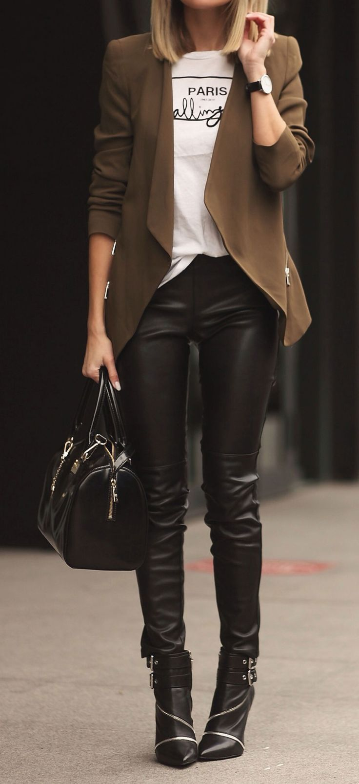 Pairing a brown open cardigan with black leather slim pants is a comfortable option for running errands in the city. go for a pair of black embellished leather booties.capitalize to va-va-voom your outfit.  Shop this look for $81:  http://lookastic.com/women/looks/ankle-boots-satchel-bag-skinny-pants-open-cardigan-crew-neck-t-shirt-watch/6747  — Black Embellished Leather Ankle Boots  — Black Leather Satchel Bag  — Black Leather Skinny Pants  — Brown Open Cardigan  — White and Black Print ...