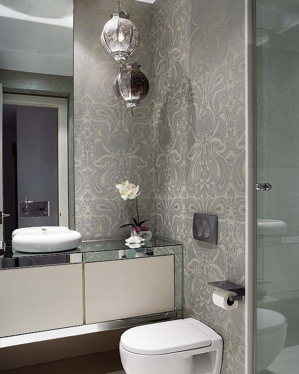 Lovely wallpaper and mirrored vanity units. Very glamorous. Malabar wallpaper by Cole & Son