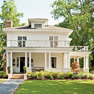 After unattractive panels were removed from the outside of this Southern Craftsmasn-Style home, the exterior wall just needed to be patched and painted to complete the restoration. | SouthernLiving.com