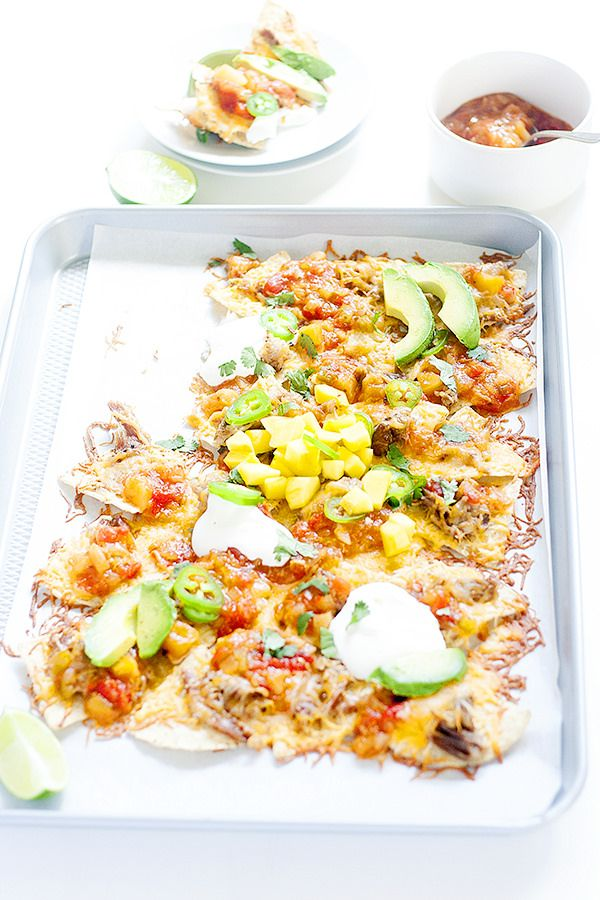 nachos go tropical for summer in these  easy mango habanero sheet pan nachos I know I probably sound like a broken record, but we have been having just the BEST. Summer. Ever. It could be the late night swim and hot tub sessions. It could be sleeping in, which we LOVE to do. But most …