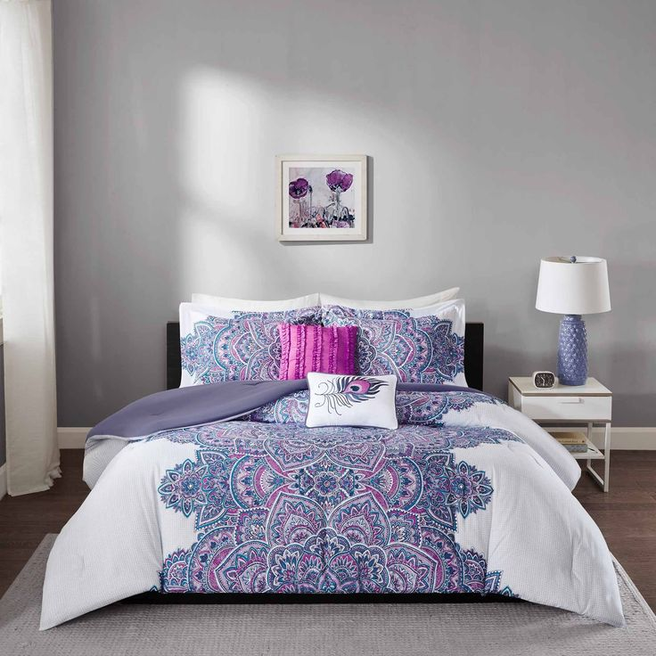 Katarina Comforter Set provides an eye-catching update to your bedroom. The textured ground has small grey circles on a white base creating dimension on the solid base.