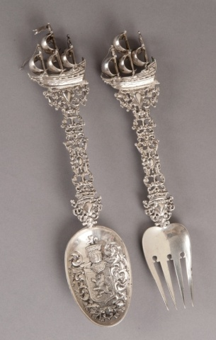"2 Continental / Belgian silver serving pieces.  A Belgian silver serving fork and spoon. 1777. With ship motif and coat of arms on spoon. 11 1/4""l x 2 1/3""w. 9.300 toz."
