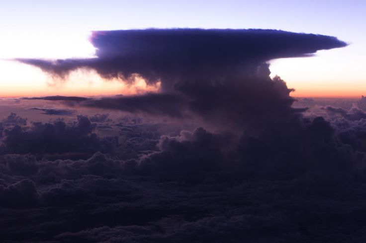 I found this terrific cloud through the window of airplane flying over Amami-Oshima Island, about 8,000 meter high. I think it was about 10km width from side to side.  「かなとこ雲」という積乱雲の一種です。奄美大島上空8000メートル付近で撮影。横に広がっている傘の部分は幅およそ10キロ近くあったかも知れません。地上からは見れない不気味な迫力のある雲でした。