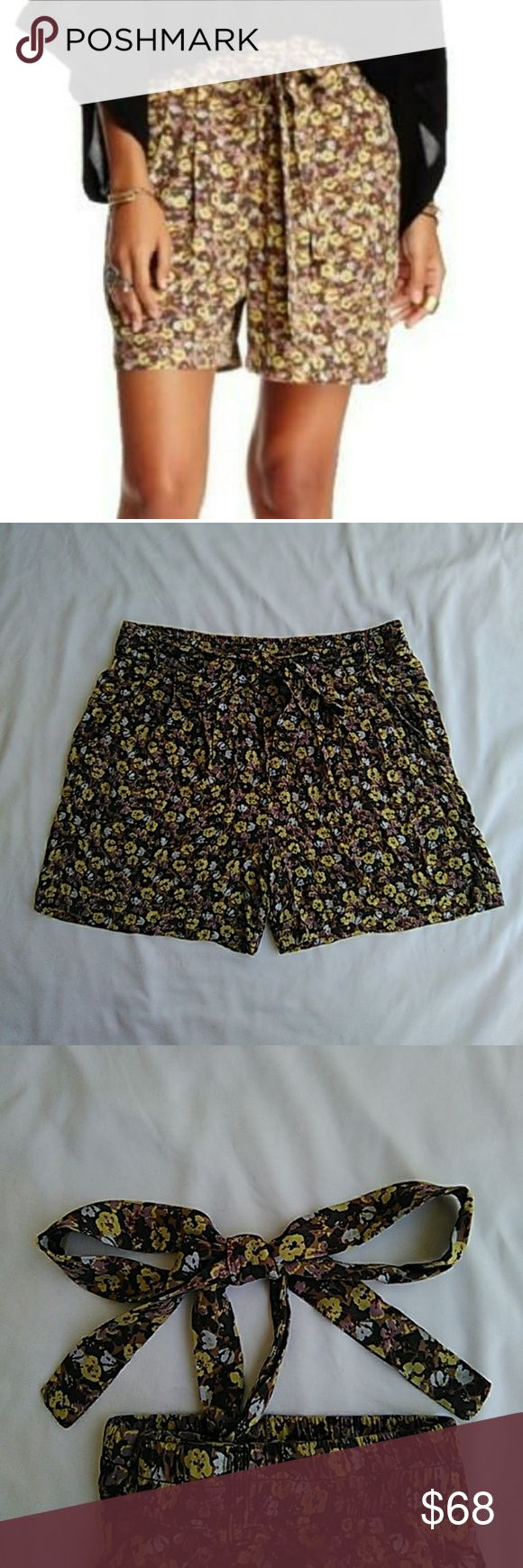 Free People multicolored floral shorts size small Free People multicolored floral shorts size small. Loose fitting with elastic waist and front tie belt. Front and back pockets. EUC. Waist laying flat 14.5, length on outside 16 thigh width 11.5 laying flat.  Would look cute with a cream or white blouse and sandals. Bundle or like your items for free shipping over $50.   Inv#KF002 a.c. Free People Shorts