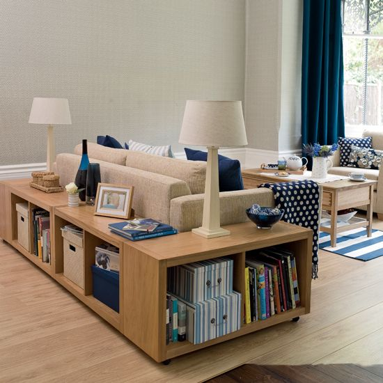 Bookcases turned on their side or low bookcases. Nice way to get storage and a place to put your drink.