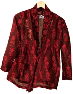 Rohini Jacket - Chocolate, True Red, Soft and contemporary, our handblock print is styled in an easy shirt jacket to layer over a tee or tank. Hand embroidered tie closures with chindi detail allow you to customize fit. Features a soft, draped neckline and slightly empire waist. Cotton voile, low-hip length. 100% cotton voile. Made by Pushpanjali