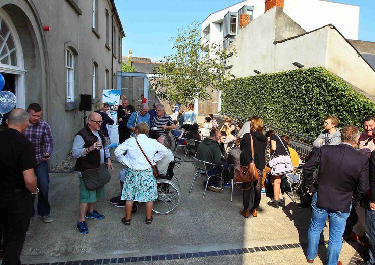 Crowd enjoying the sunny morning in Garter Lane Arts Centre www.noelbrownephotographer.com — at Garter Lane Arts Centre.