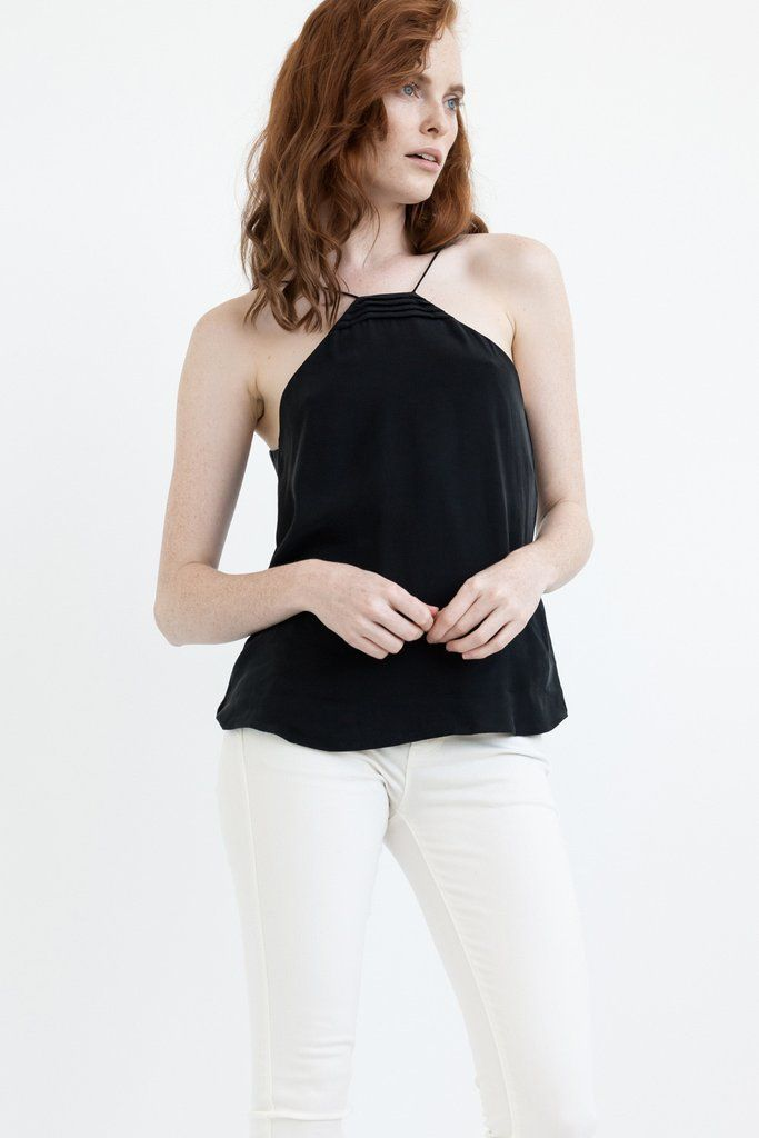 """DETAILS:   2 in 1 CAMISOLE is designed to be worn two way: front and back Darts near breast area Modern trapezium neck linewith our NEVILLEE signature design  FIT:  Relaxed fit For a super relaxed fit stick to your regular sizingOR fora fitted look (around the body), go a size down.  Jemmawears size XS. She is 5'75,"""" Bust 32,"""" Waist 24,"""" Hips 35"""" FABRIC:  Pre-shrunk 100% Premium Diamond Wash Silk® - super soft silky touch. Silk is light-weight and breathable which means, cooling in…"""