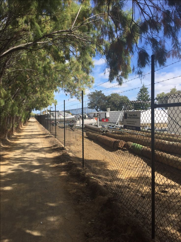 South Perth Yacht Club chain mesh fencing - Adding barb wire to the top of the fence to complete job.