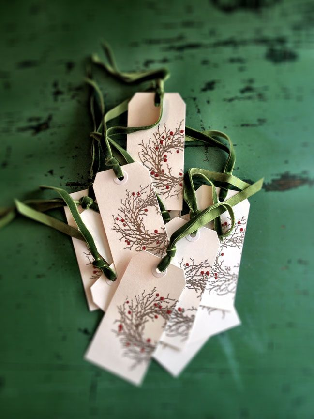 "Here's a quick tutorial for some lovely but easy Christmas gift tags... The supplies and tools you'll need:  A heat tool like this (not in photo), some white shipping tags (mine are about 4""), a paintbrush, a wreath rubber stamp like this one  or this one, some red fluid acrylic paint, an…"