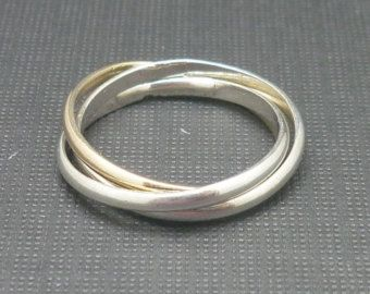 3 Intertwined Rings - 2 Sterling Silver and 1 Gold, Rolling / Interlocking Rings. Very easy to wear and they look fantastic! Would you like your very own?  Click through to purchase.