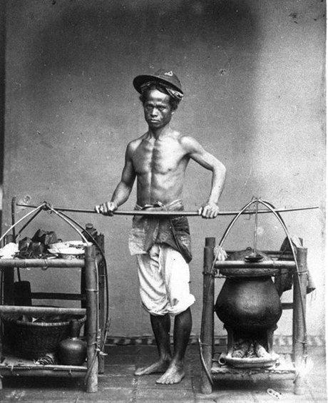 A man from Batavia carrying his warung (c. 1870)