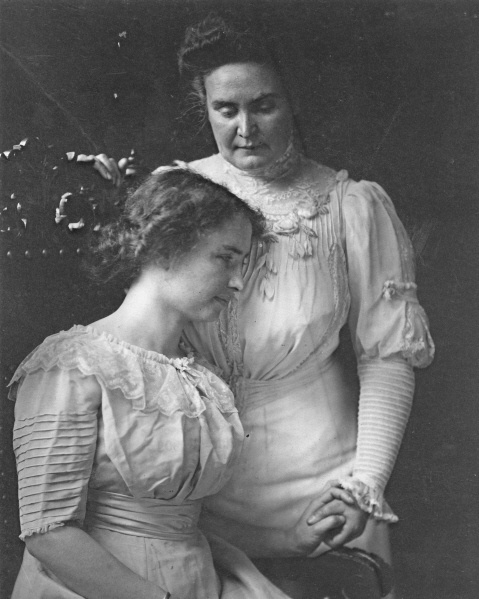 Helen Keller, seated, holding hand of her teacher,  Anne Sullivan. One of the best examples of teacher and student I can think of.
