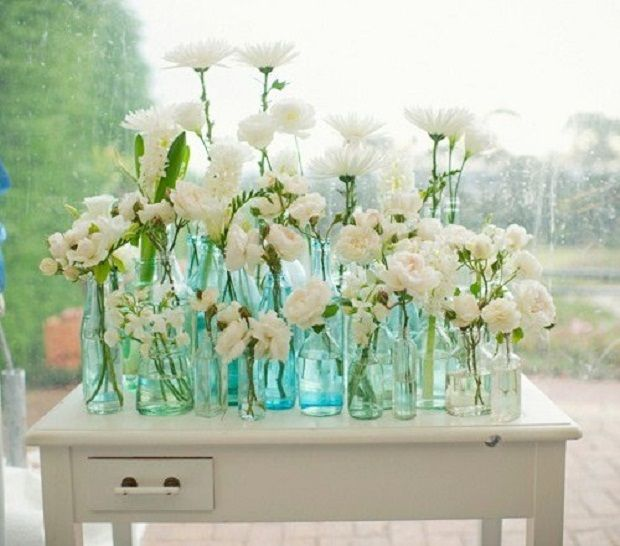 White flowers in vintage bottles.
