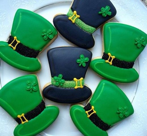St. Pattys Day chocolate sugar cookies covered in vanilla royal icing.