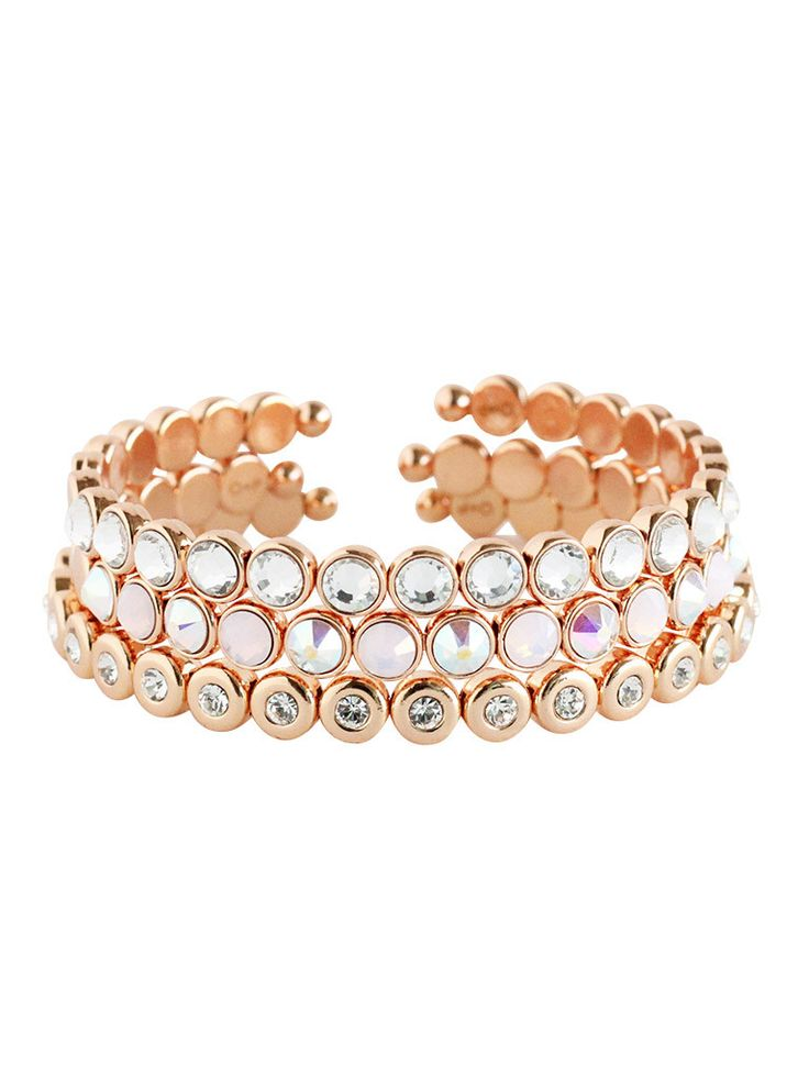 Deck out your wrist in a luxe and versatile rose gold bracelet set. Featuring a mix of clear and blush crystals and iridescent shimmer.