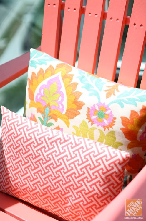Bright colors and bold design are the defining features of this DIY backyard makeover from @homedepot. Amber didn't have a lot of space to work with on her small balcony, but she still wanted to make a big impact. By including colorful DIY projects, like this wooden adirondack chair in a bright shade of BEHR Paint's Youthful Coral, Amber was able to decorate her small outdoor space.