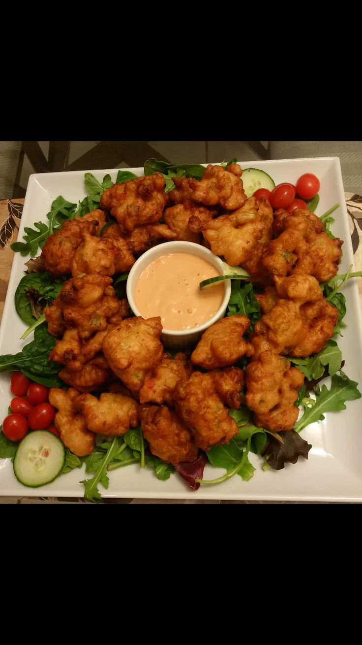 Dena's Conch Fritters on Salad Greens. DELICIOUS!!!!