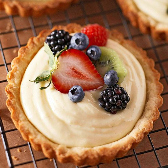 Sinfully rich cream chilled in a pastry shell is topped with colorful fruit to create this refreshing dessert. The tarts can be assembled and refrigerated up to four hours before serving./
