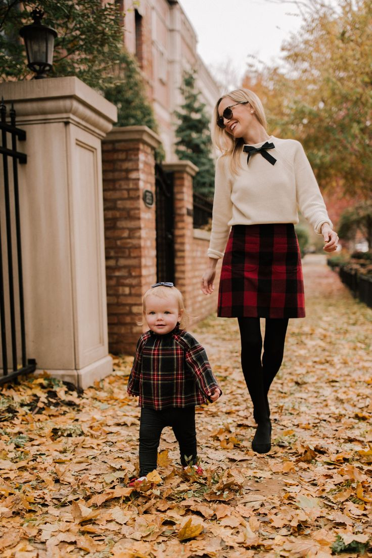 Preppy holiday outfit for mom and daughter. Wear a plaid skirt, white top with a bow, and look super festive for the holidays. #holidayoutfit