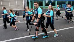 Conor McGrory, 23, of Butler, who has been paralysed from the waist down after a motor bike crash in 2014, was aided by his fiance Ellie Pollard, 22, as he joined participants in this year's HBF Run For A Reason in Perth today, Sun'. He walks with the aid of a $130,000 exoskeleton. Buy or browse all images at wespix.com.au. PICTURE: NIC ELLIS   THE WEST AUSTRALIAN. TWA-0045185 © WestPix