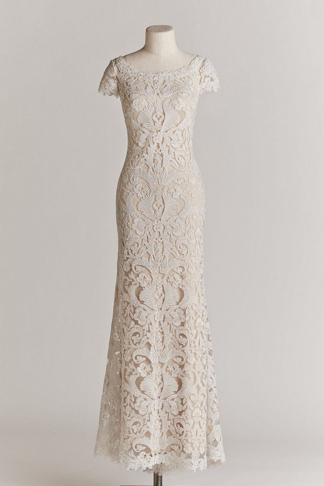 Chic, Sophisticated Wedding Dresses for Romantics: The August gown from designer Tadashi Shoji is made from luxurious fabrics, achieving an impeccably tailored fit. With a wide, scalloped neckline, plunging v back and stunning lace train, this curve-hugging ivory gown exudes classic beauty.