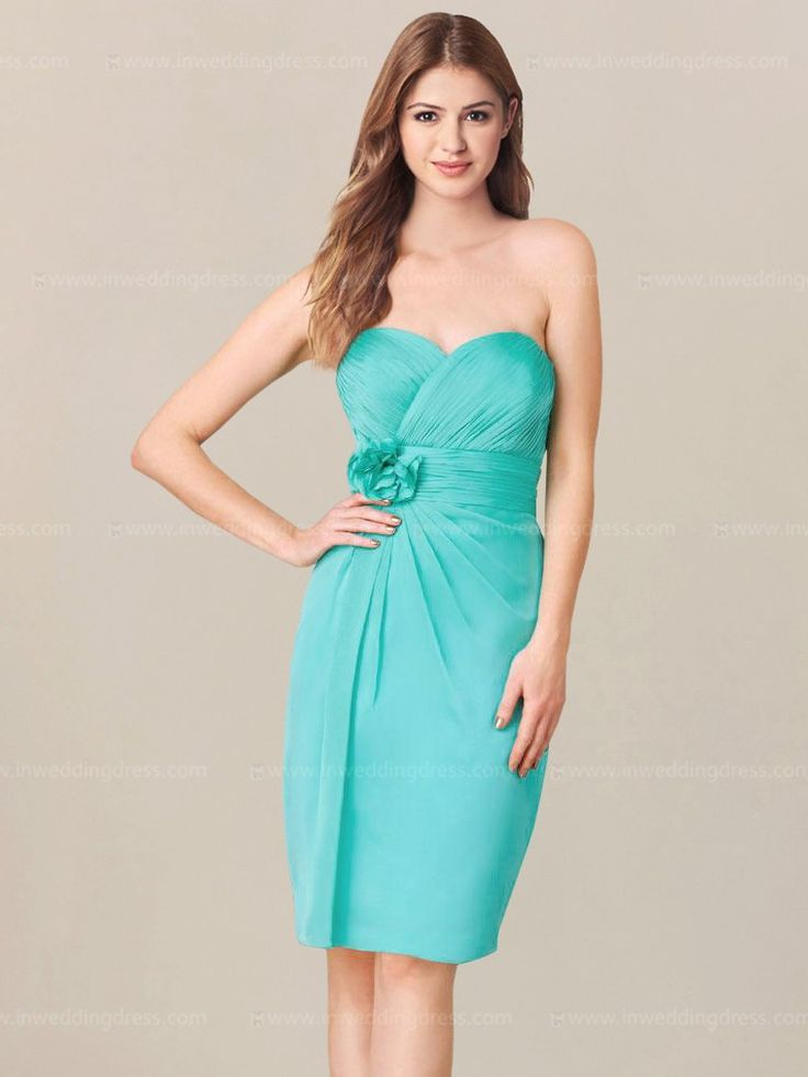 Destination bridesmaid dress features a shirred bodice with strapless sweetheart neckline. Eye-catching floral appliques are accented at the waist.