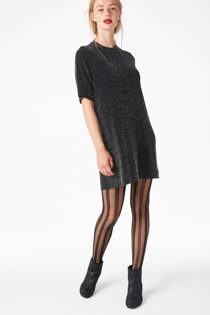 <p>Cool off your disco fever with this glittery t-shirt dress with a high round-neck. This piece is all things cool, easy 'n' elegant.<br /><br />In a size