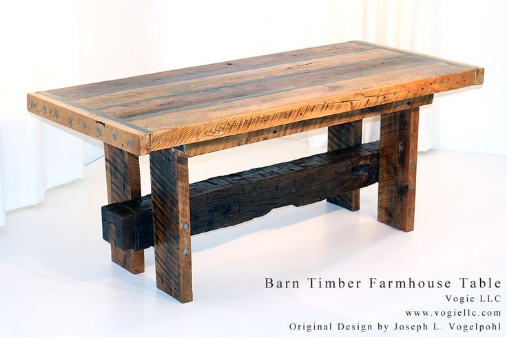 The Reclaimed Barn Timber Farmhouse Table is a massive dining table built from hand hewn reclaimed Oak and Maple barn timber harvested from fallen Michigan and Ohio barns built in the late 1800's and early 1900's. To match the barn construction style of the times this table is constructed with wooden dowels.  The table is trimmed with flat bar and round stock adding a unique but recognizable characteristic of many Vogie designs.
