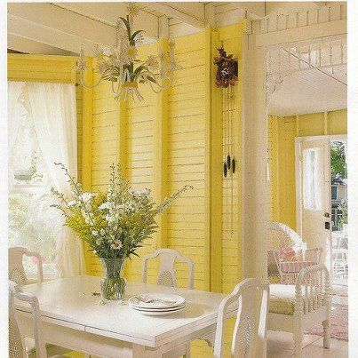 Love the sunny yellow porch & fresh flowers!