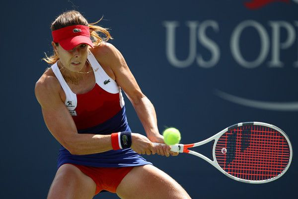 Alize Cornet Photos - Alize Cornet of France returns a shot during her first round Women's Singles match against Heather Watson of Great Britain on Day One of the 2017 US Open at the USTA Billie Jean King National Tennis Center on August 28, 2017 in the Flushing neighborhood of the Queens borough of New York City. - 2017 US Open Tennis Championships - Day 1