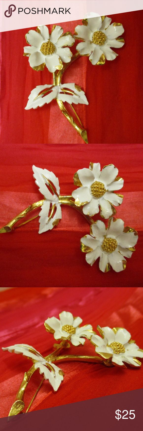 """Vintage White Gold Signed Floral Trembler Brooch Wonderful 1970s smooth and textured gold tone metal flower trembler brooch accented with white enamel.  This outstanding en tremblant has daisy style flowers set on springs that make flowers jiggle and bounce with every movement ~ thus the term TREMBLER or en tremblant. Enamel is for accent only and not intended to cover entire surface.  Signed but not readable. 2 1/2"""" x 2"""" x 3/4"""" deep. Secure rollover clasp. Charming gift for her. EUC  23g…"""