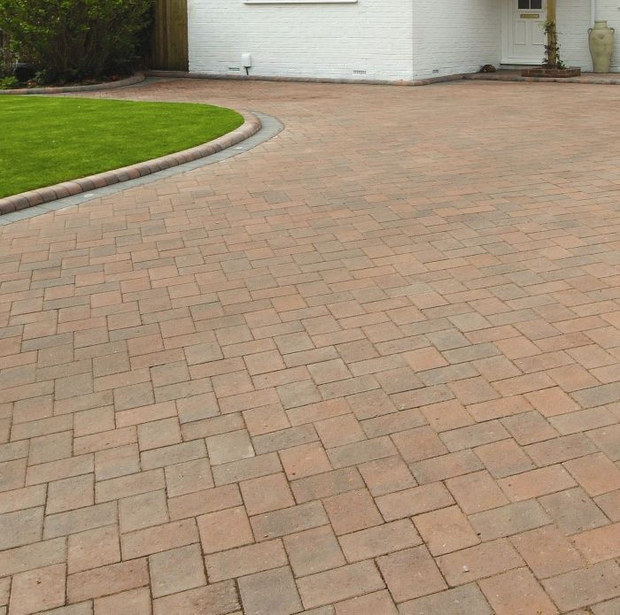 This elegant and modern block paved driveway has been created using Brett Beta 60mm Large 210x140mm paving bricks with contrasting silver grey edging stones
