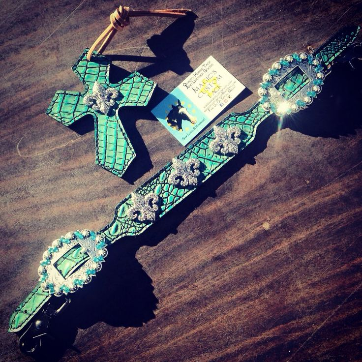 Magics Custom Tack Turquoise teal saddle cross and wither strap with blingy fluer de Lis conchos Www.magicscustomtack.com barrel racing rodeo horse riding tack dog cat collars leatherwork mounted shooting