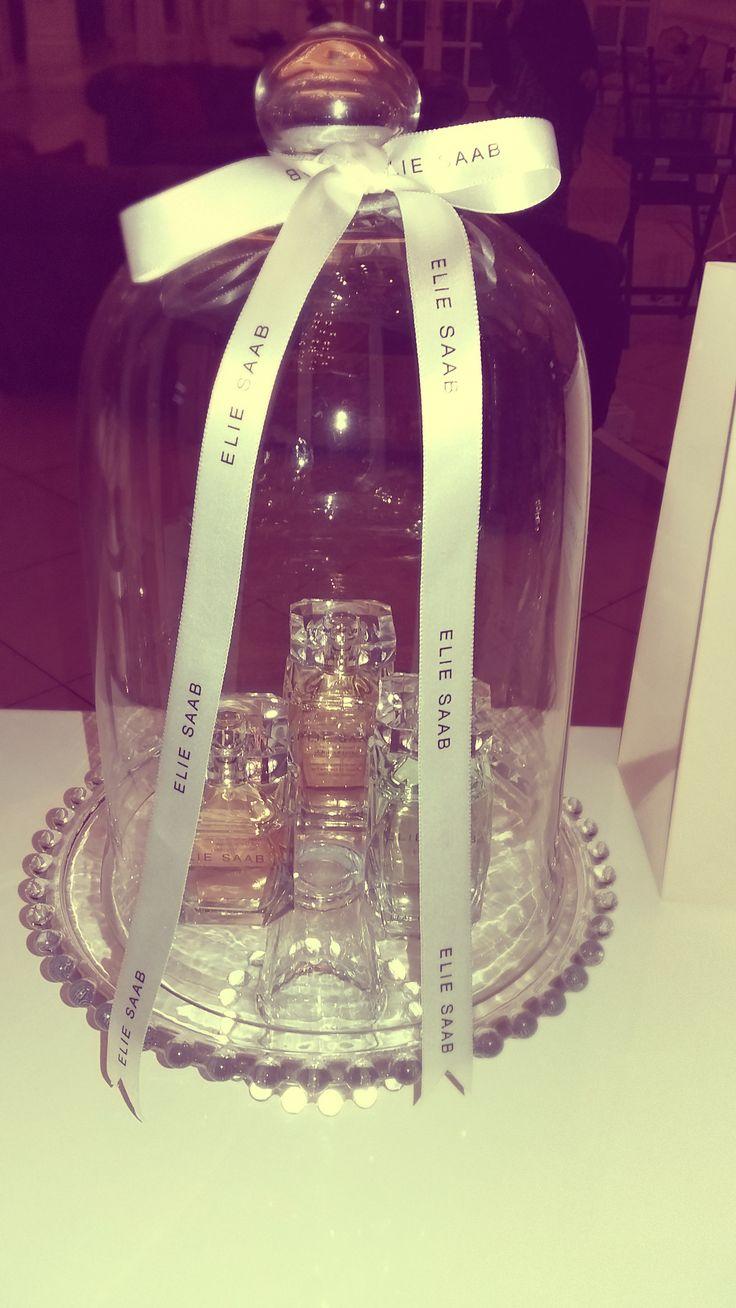Elie Saab Perfumes on display under glass domes