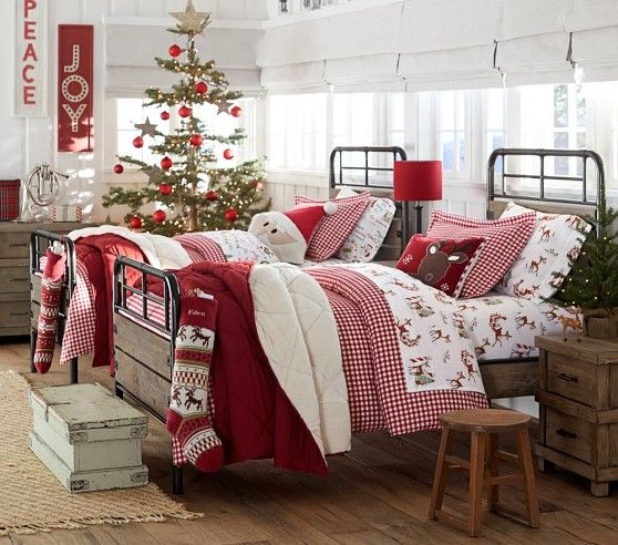 Christmas bedroom. Themed bedding for twin beds. From Pottery Barn Kids Holiday 2014. Rudolph the Red Nosed Reindeer & Night Before Christmas sheets. Red gingham duvet cover & sham. Personalized monogrammed stockings hanging at the end of the bed. Decorated Christmas tree in room. Mini lit tree on nightstand. Kid's room. *Love the Santa pillow.