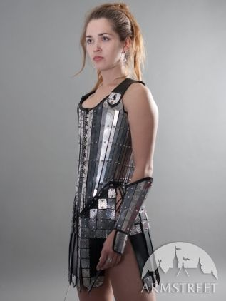 Etched Armor Corset from Armstreet. I'll probably never be brave enough to rock something like this on Barbarian Weekend at Ren Faire but this is one of the way cooler versions of female armor and a lot more secure and less daunting than the chainmail bikini lol