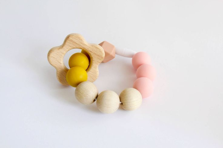Teething Bracelet. Bpa free silicone beaded bracelet with natural wooden flower ring teether ring by Mustard & Mint by mustardandmintuk on Etsy https://www.etsy.com/uk/listing/508845636/teething-bracelet-bpa-free-silicone