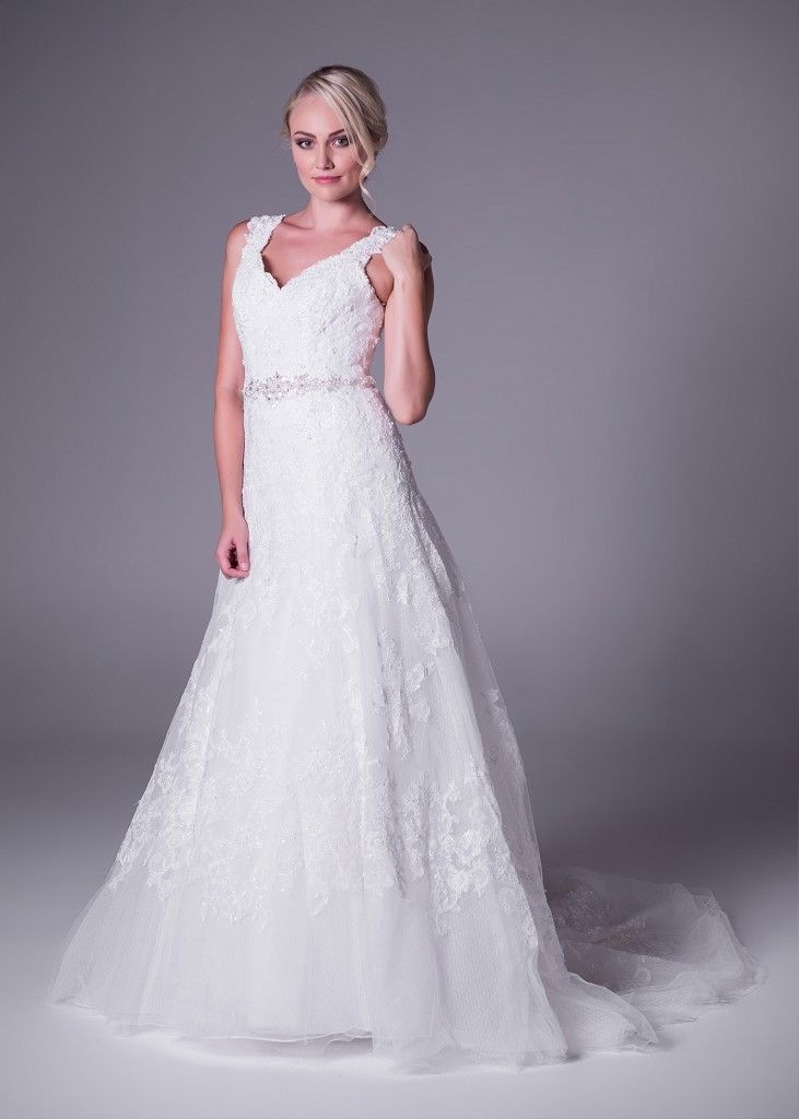 Vintage Dreams! Iconic style by Oleg Cassini. This flattering A-line #gown with all-over lace and beaded belt detail is the epitome of vintage elegance. Only at Bride&co (style CWG672). Click to Book a Fitting